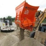 EZG Manufacturing's Hog Crusher pulverizing debris into small pieces.